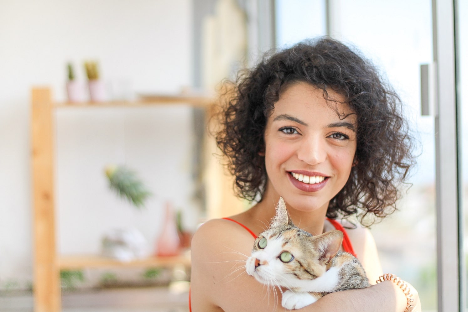 cat owner supporting their cat with CBD for Cats